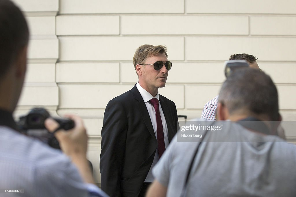 Terry Farr, a former broker at RP Martin Holdings Ltd., center, arrives to appear at Westminster Magistrates Court in London, U.K., on Friday, July 19, 2013. Two former RP Martin Holdings Ltd. employees, Farr, and James Gilmour, who became the first brokers to face prosecution in the global probe of manipulation of the London interbank offered rate made their first appearance in a London courtroom. Photographer: Simon Dawson/Bloomberg via Getty Images