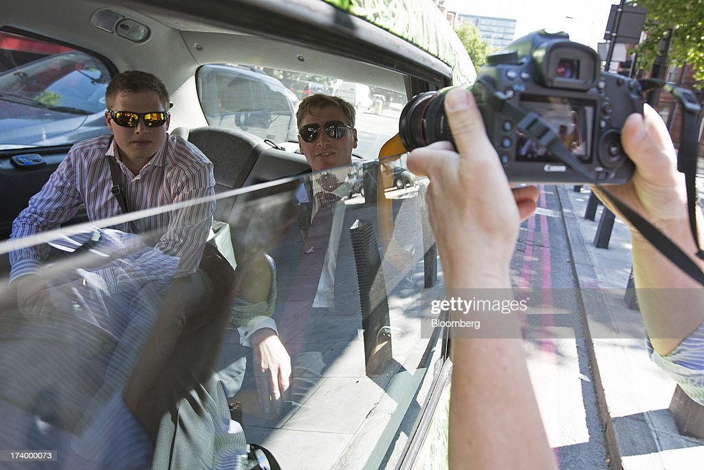 Terry Farr, a former broker at RP Martin Holdings Ltd., right, leaves in a taxi after appearing at Westminster Magistrates Court in London, U.K., on Friday, July 19, 2013. Two former RP Martin Holdings Ltd. employees, Farr, and James Gilmour, who became the first brokers to face prosecution in the global probe of manipulation of the London interbank offered rate made their first appearance in a London courtroom. Photographer: Simon Dawson/Bloomberg via Getty Images