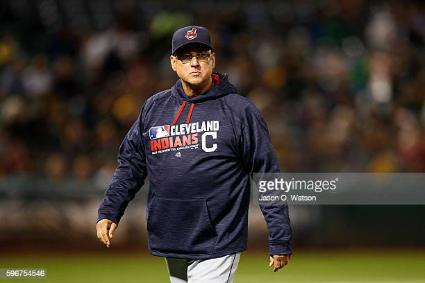 Terry Francona of the Cleveland Indians returns to the dugout after making a pitching change against the Oakland Athletics during the fifth inning at...