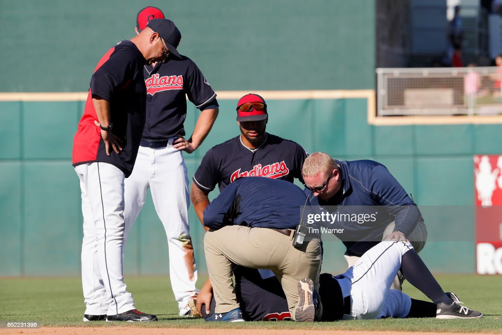 Terry Francona #17 of the Cleveland Indians watches as medical staff attend to Guillermo Quiroz #63 in the ninth inning against the Kansas City Royals during the spring training game at Goodyear Ballpark on March 11, 2017 in Goodyear, Arizona.
