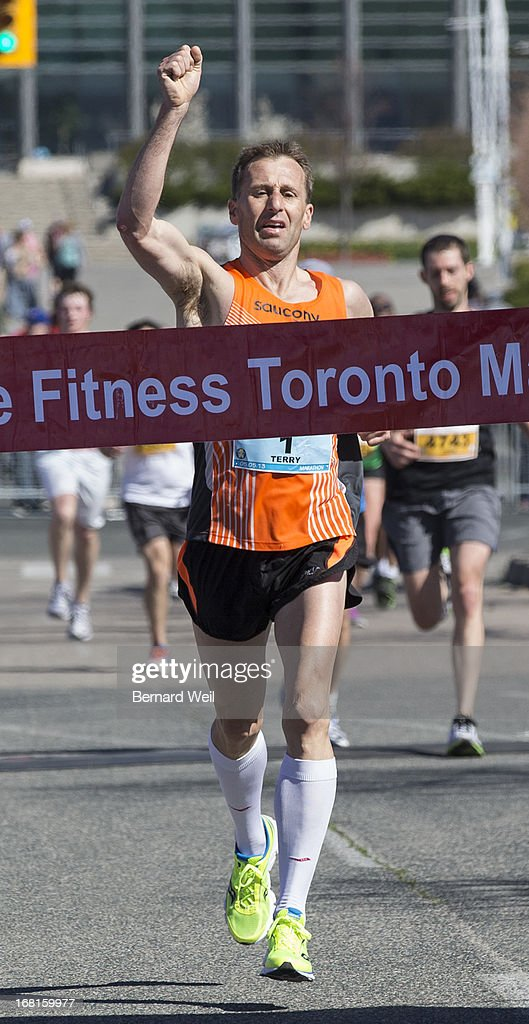 Terry Gehl, of St. Charles-Sur Richelieu, is the first to cross the finish line at Ontario Place in 2:37:30.1 in the Toronto Marathon.