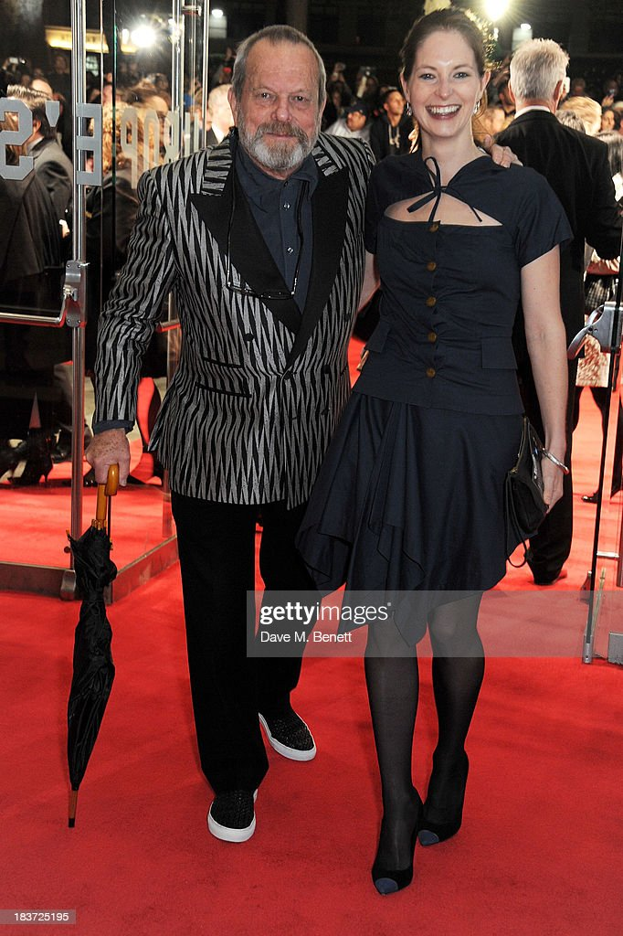 Terry Gilliam (L) and Amy Gilliam attend the European Premiere of 'Captain Phillips' on the opening night of the 57th BFI London Film Festival at Odeon Leicester Square on October 9, 2013 in London, England.