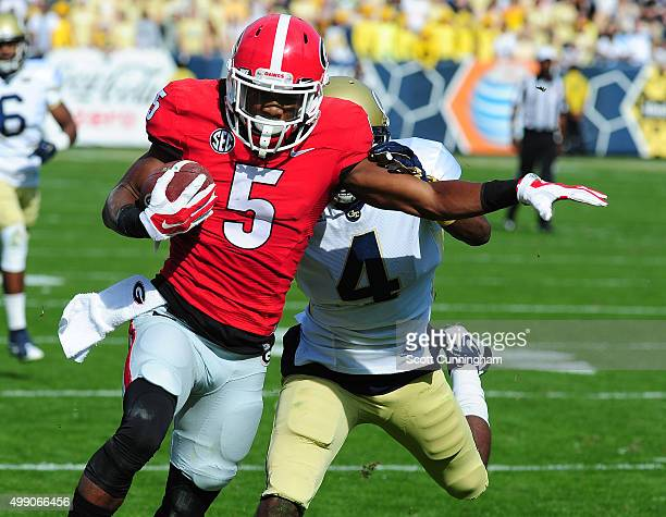 Terry Godwin of the Georgia Bulldogs makes a first half catch against Jamal Golden of the Georgia Tech Yellow Jackets at Bobby Dodd Stadium on...