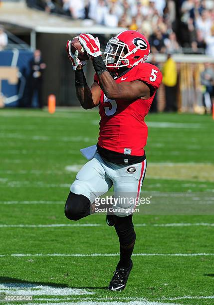 Terry Godwin of the Georgia Bulldogs makes a first half catch against the Georgia Tech Yellow Jackets at Bobby Dodd Stadium on November 28 2015 in...