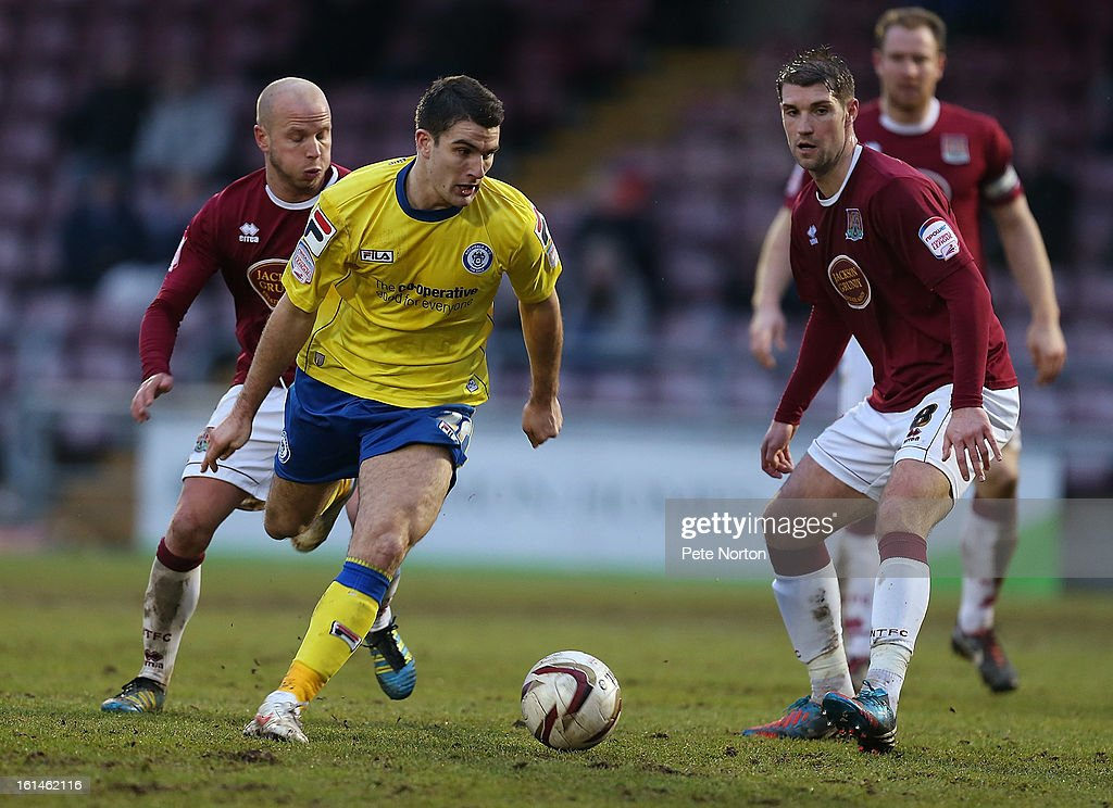 Terry Gornell of Rochdale looks for the ball with Ben Harding (r) and Luke Guttridge of Northampton Town during the npower League Two match between Northampton Town and Rochdale at Sixfields Stadium on February 9, 2013 in Northampton, England.