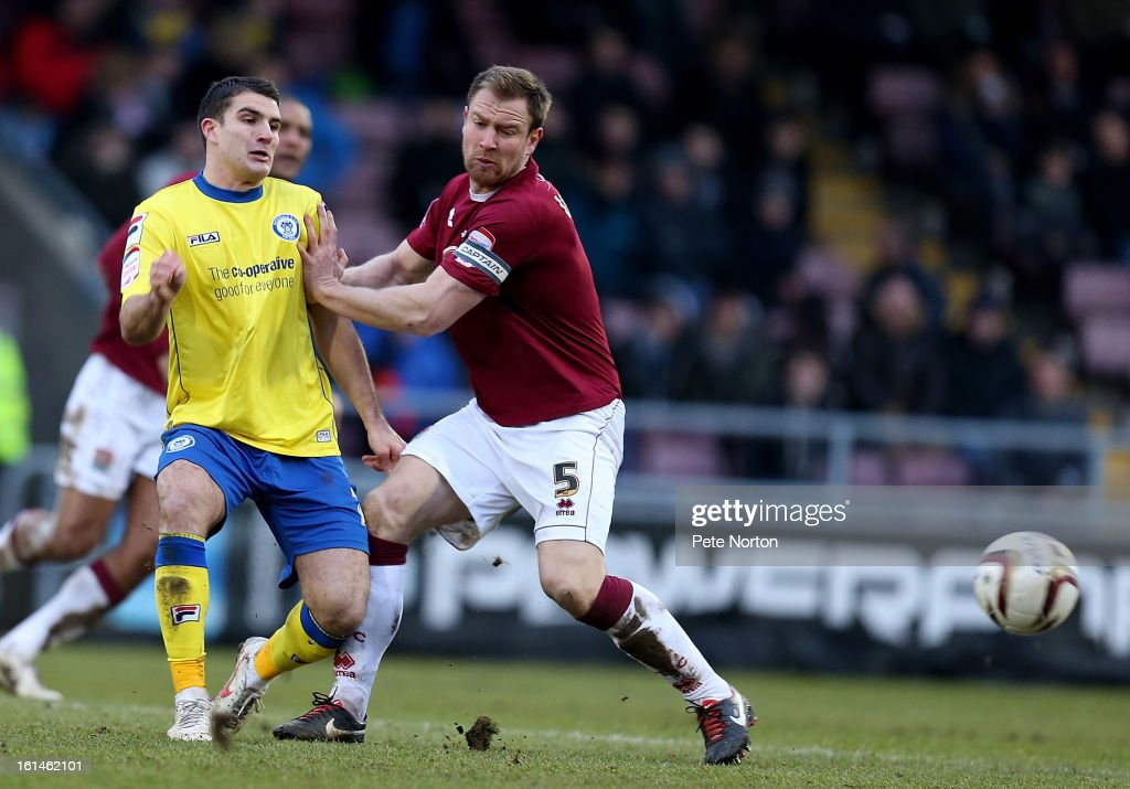 Terry Gornell of Rochdale plays the ball under pressure from Kelvin Langmead of Northampton Town during the npower League Two match between Northampton Town and Rochdale at Sixfields Stadium on February 9, 2013 in Northampton, England.