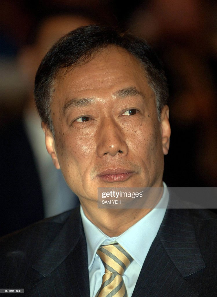 Terry Guo, founder of the Foxconn Electronics Inc. listens during the celebration of the company's 30th anniversary in Taipei, 25 October 2006. The world's fourth-largest branded personal computer vendor said 25 October it is confident of attaining its goal of bumping rival Lenovo and becoming the world's number three PC brand in 2007. AFP PHOTO/Sam YEH