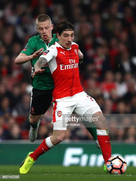 Terry Hawkridge of Lincoln City puts pressure on Hector Bellerin of Arsenal during The Emirates FA Cup QuarterFinal match between Arsenal and Lincoln...