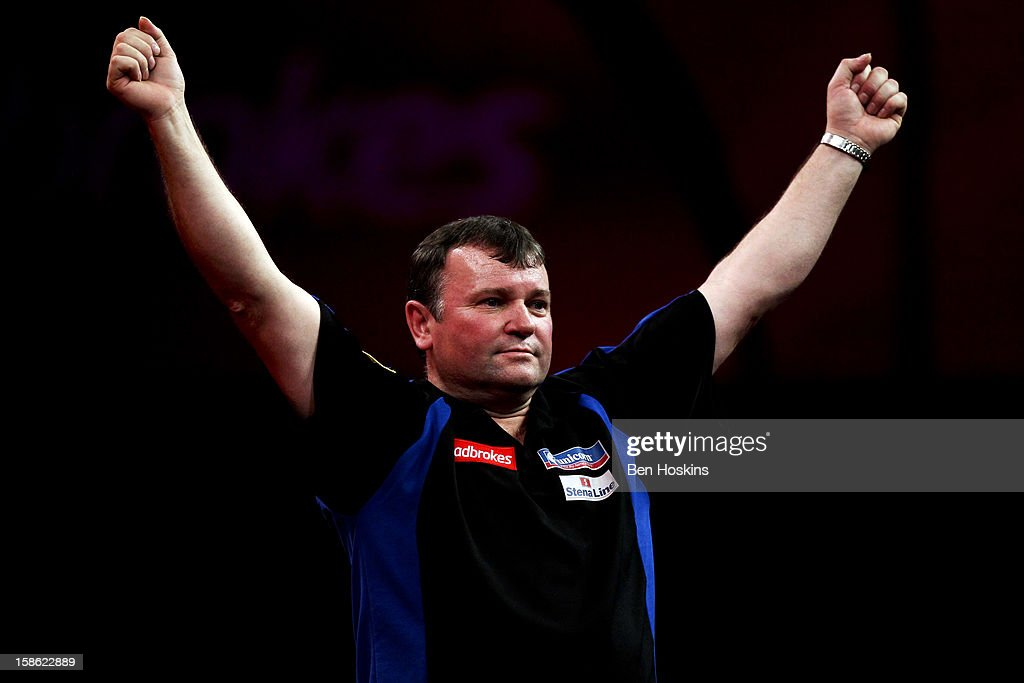 Terry Jenkins of England celebrates his win during his second round match on day eight of the 2013 Ladbrokes.com World Darts Championship at the Alexandra Palace on December 21, 2012 in London, England.