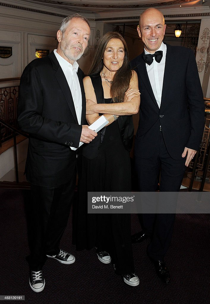 Terry Jones and Tricia Jones, winners of the Outstanding Achievement Award, pose with presenter Dylan Jones at the British Fashion Awards 2013 at London Coliseum on December 2, 2013 in London, England.