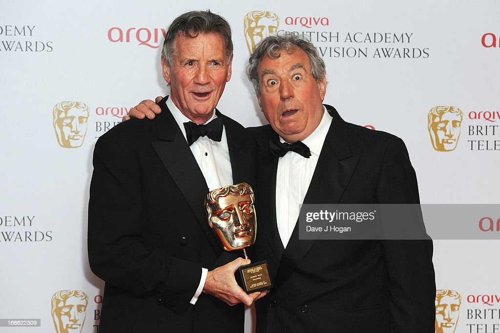 Terry Jones poses with <a gi-track='captionPersonalityLinkClicked' href=/galleries/search?phrase=Michael+Palin&family=editorial&specificpeople=208240 ng-click='$event.stopPropagation()'>Michael Palin</a> after presenting him with The Fellowship Award in front of the winners boards at the BAFTA TV Awards 2013 at The Royal Festival Hall on May 12, 2013 in London, England.