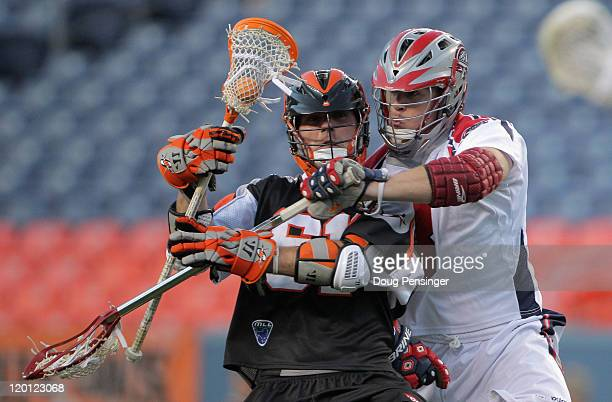 Terry Kimener of the Denver Outlaws controls the ball against Patrick Heim of the Boston Cannons during their Major League Lacrosse match at INVESCO...