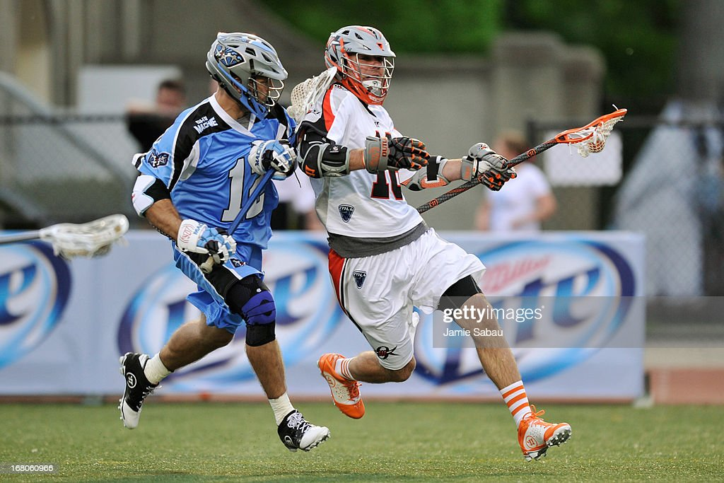 Terry Kimener #16 of the Denver Outlaws controls the ball in the first period as Ray Megill #12 of the Ohio Machine defends on May 4, 2013 at Selby Stadium in Delaware, Ohio. Denver defeated Ohio 13-8.