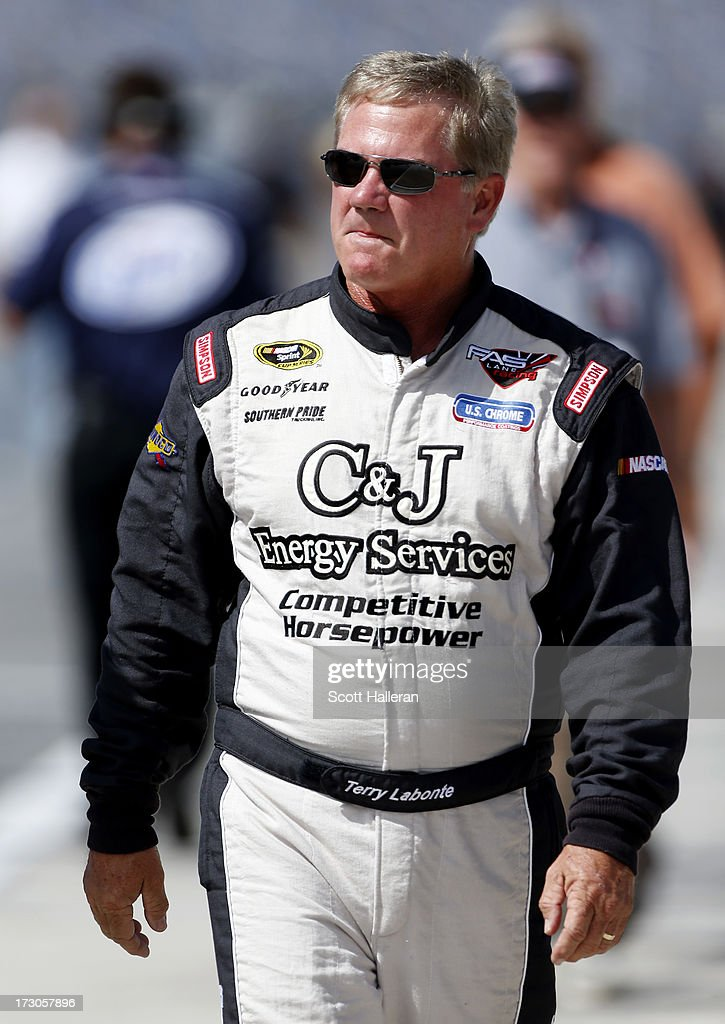 <a gi-track='captionPersonalityLinkClicked' href=/galleries/search?phrase=Terry+Labonte&family=editorial&specificpeople=241205 ng-click='$event.stopPropagation()'>Terry Labonte</a>, driver of the #32 C & J Energy Ford, walks down the grid during qualifying for the NASCAR Sprint Cup Series Coke Zero 400 at Daytona International Speedway on July 5, 2013 in Daytona Beach, Florida.