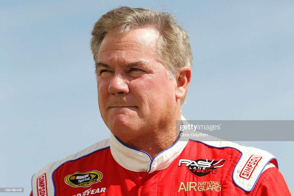 Terry Labonte driver of the CJ Energy Ford walks in the garage area during practice for the NASCAR Sprint Cup Series Daytona 500 at Daytona...