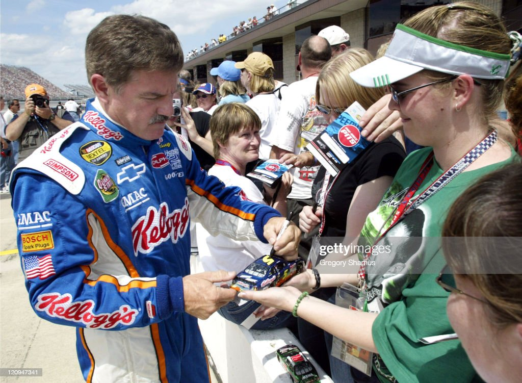 Terry Labonte signs autographs before his qualifying attempt for the NASCAR Nextel Cup DHL 400 at Michigan International Speedway in Brooklyn Mich...