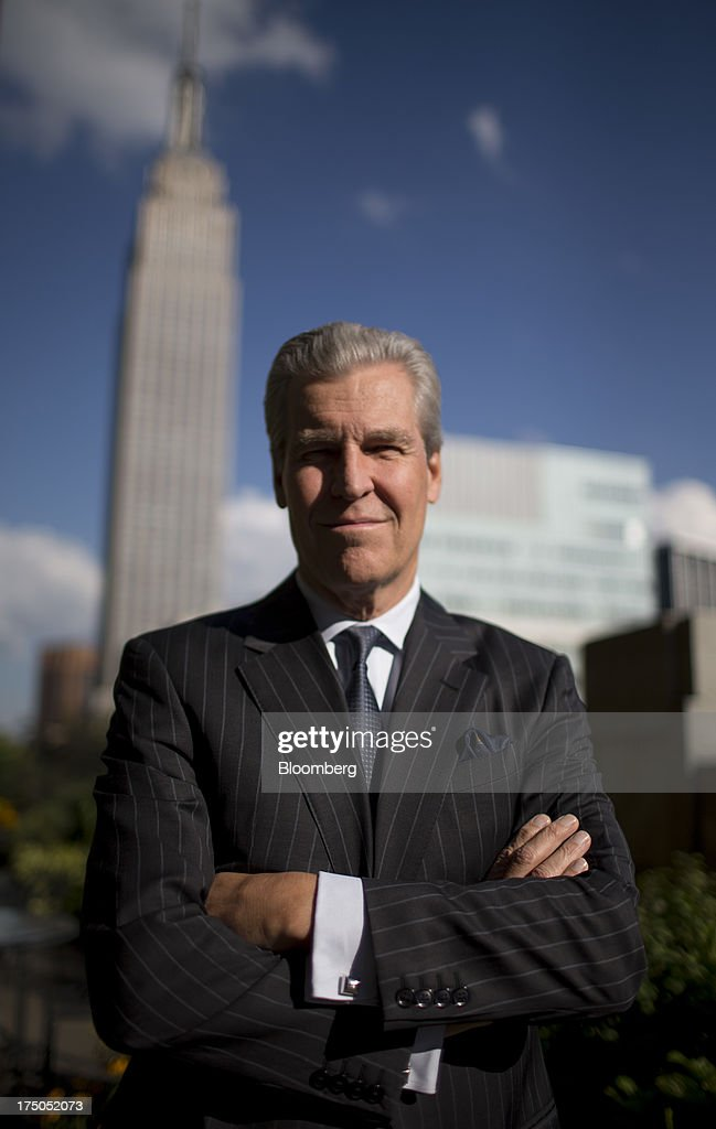 Terry Lundgren, chairman, president and chief executive officer of Macy's Inc., stands for a photograph in New York, U.S., on Monday, July 29, 2013. Lundgren recently said the company will not follow other retailers'charge into Canada for now, given the size of the Canadian population and appetite for fashion. Photographer: Scott Eells/Bloomberg via Getty Images