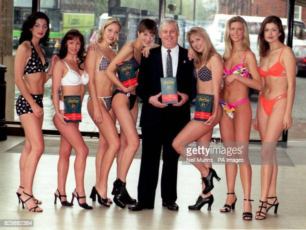 Terry Major Ball brother of the Prime Minister John Major smiles broadly as he finds himself surrounded by bikiniclad women at the Royal Albert Hall...