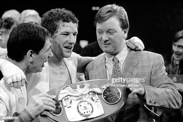 Terry Marsh and promoter Frank Warren celebrate with the belt after Terry Marsh beat Joe Manley by a TKO in the tenth round to win the IBF Light...