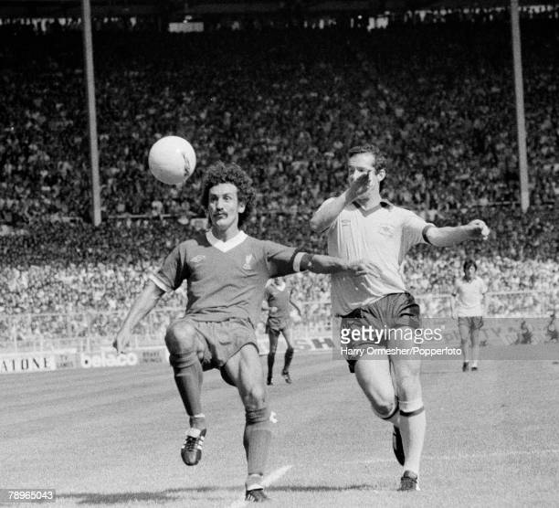 11th August 1978 Wembley Stadium London FA Charity Shield Liverpool 3 v Arsenal 1 Liverpools Terry McDermott is challenged by Arsenals Liam Brady