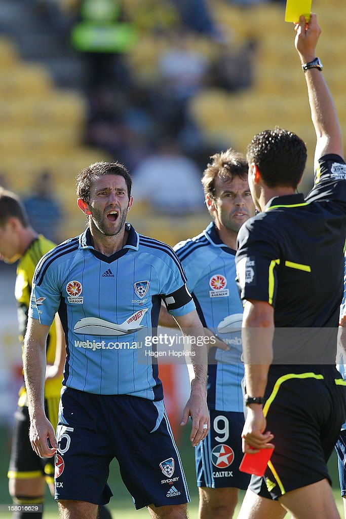 Terry McFlynn of Sydney FC looks on as referee Kris Griffiths-Jones issues a red card during the round 10 A-League match between Wellington Phoenix and Sydney FC at Westpac Stadium on December 9, 2012 in Wellington, New Zealand.