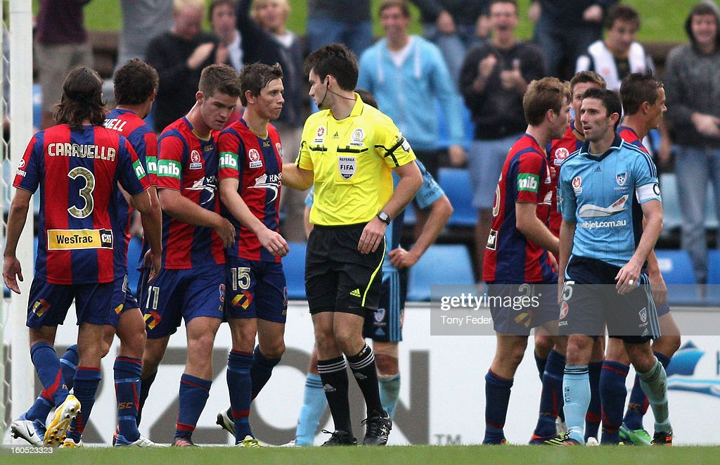Terry McFlynn of Sydney is sent off by the referee and the Jets are awarded a penalty during the round 19 A-League match between the Newcastle Jets and Sydney FC at Hunter Stadium on February 2, 2013 in Newcastle, Australia.