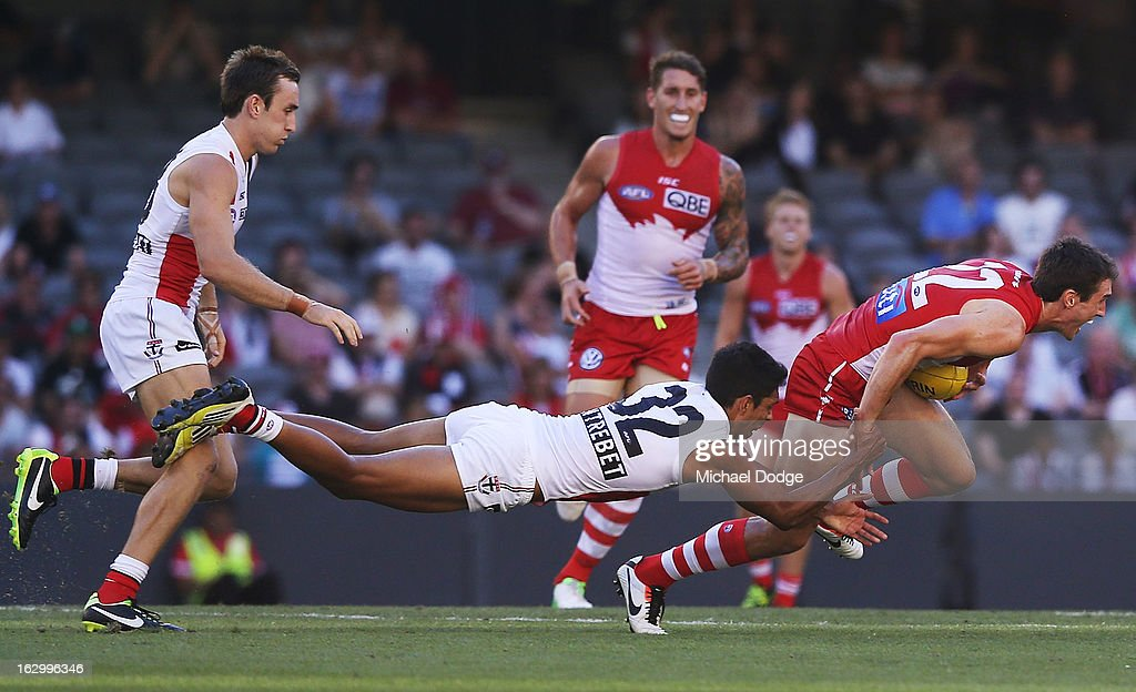 Terry Milera of the St.Kilda Saints tackles Dean Towers of the Sydney Swans during the round two AFL NAB Cup match between the St Kilda Saints and the Sydney Swans at Etihad Stadium on March 3, 2013 in Melbourne, Australia.
