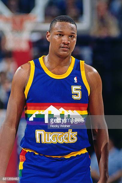 Terry Mills of the Denver Nuggets walks up court during a game against the Sacramento Kings circa 1991 at Arco Arena in Sacramento California NOTE TO...