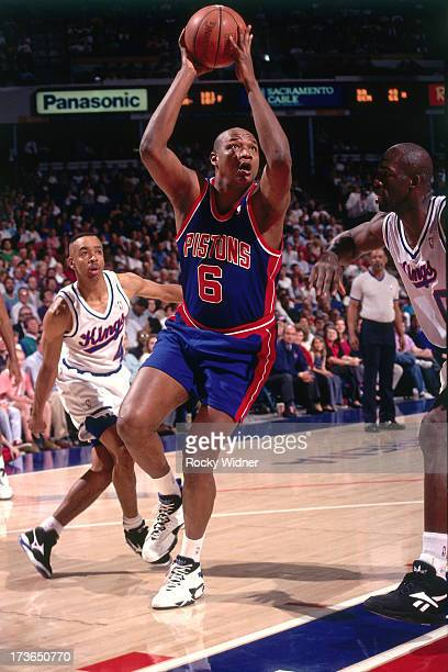 Terry Mills of the Detroit Pistons drives against the Sacramento Kings during a game played on March 14 1994 at Arco Arena in Sacramento California...