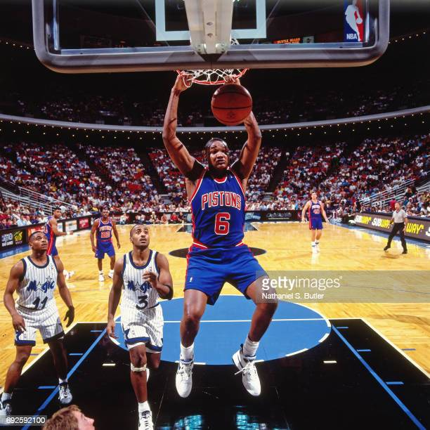Terry Mills of the Detroit Pistons dunks the ball during a game against the Orlando Magic circa 1994 at Orlando Arena in Orlando Florida NOTE TO USER...