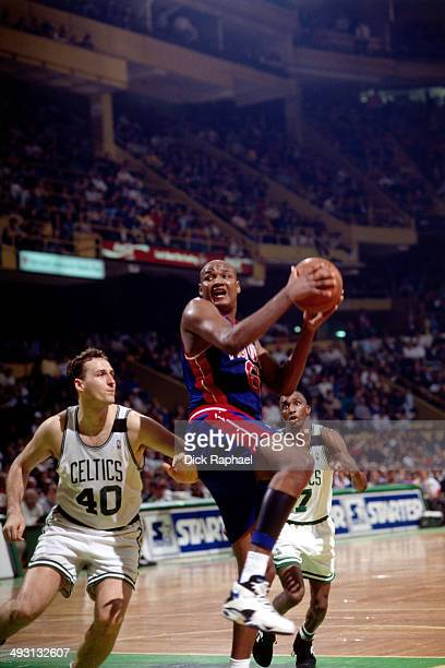 Terry Mills of the Detroit Pistons handles the ball inside against Dino Radja of the Boston Celtics during a game played circa 1994 at the Boston...