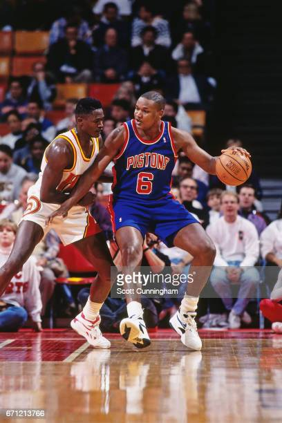 Terry Mills of the Detroit Pistons posts up against the Atlanta Hawks during a game played circa 1990 at the Omni in Atlanta Georgia NOTE TO USER...