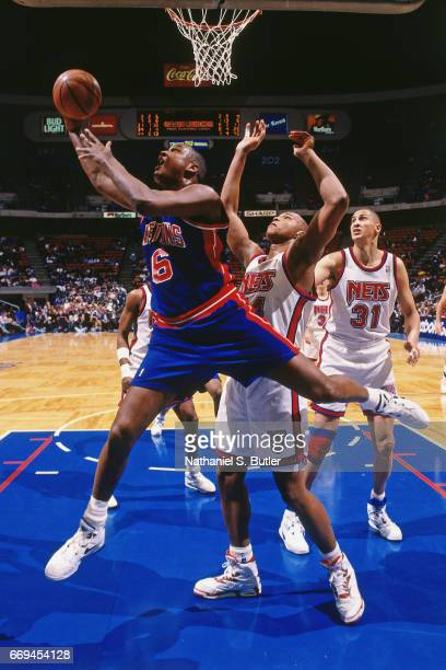Terry Mills of the Detroit Pistons shoots against the New Jersey Nets during a game played circa 1993 at the Brendan Byrne Arena in East Rutherford...
