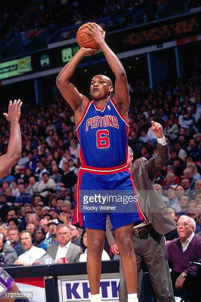 Terry Mills of the Detroit Pistons shoots against the Sacramento Kings during a game played on February 26 1996 at Arco Arena in Sacramento...