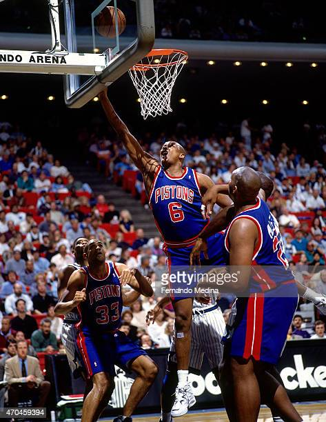 Terry Mills of the Detroit Pistons shoots the ball against the Orlando Magic on April 5 1995 at the Orlando Arena in Orlando Florida NOTE TO USER...