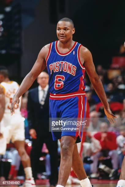 Terry Mills of the Detroit Pistons walks against the Atlanta Hawks during a game played circa 1990 at the Omni in Atlanta Georgia NOTE TO USER User...