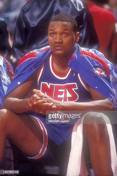 Terry Mills of the New Jersey Nets on the bench during a basketball game against the Washington Bullets at the Capitol Centre on March 25 1991 in...