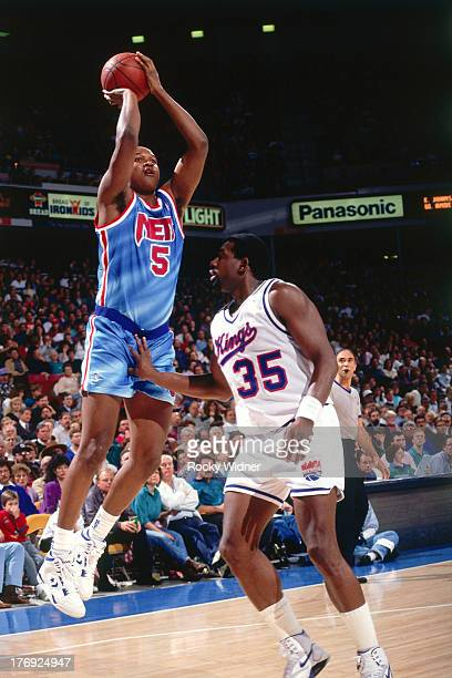 Terry Mills of the New Jersey Nets shoots the ball against the Sacramento Kings on January 28 1991 at Arco Arena in Sacramento California NOTE TO...