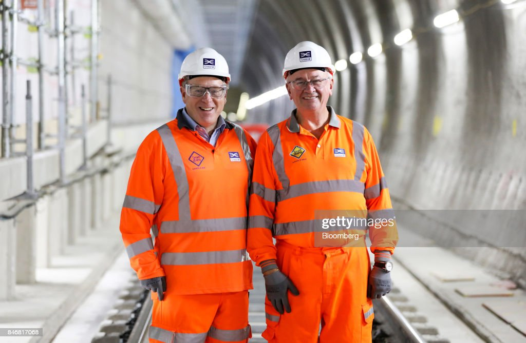 Terry Morgan, chairman of Crossrail Ltd., right, and Andrew Wolstenholme, chief executive officer of Crossrail Ltd., pose for a photograph during an event in a tunnel near Whitechapel station to celebrate the completion of the permanent Crossrail Ltd. track on the Elizabeth line in London, U.K., on Thursday, Sept. 14, 2017. Crossrail, which will be known as the Elizabeth Line once its up and running, hasnt yet set fares, but transit agency Transport for London has indicated they will be significantly less than Heathrow Express with a charging structure more akin to the Tube. Photographer: Chris Ratcliffe/Bloomberg via Getty Images