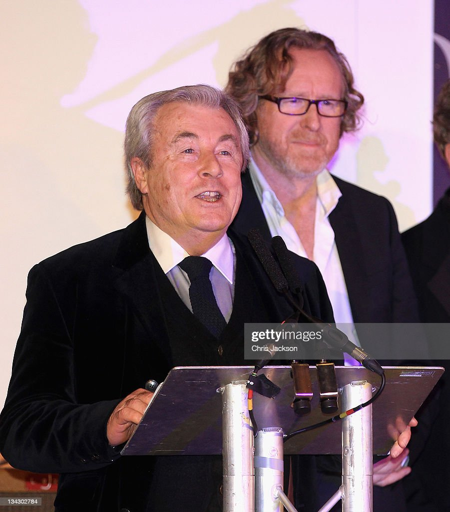 Terry O'Neil talks as photographer Alistair Morrison attends Hidden Gems Photography Gala Auction in support of Variety Club at St Pancras Renaissance Hotel on November 30, 2011 in London, England.