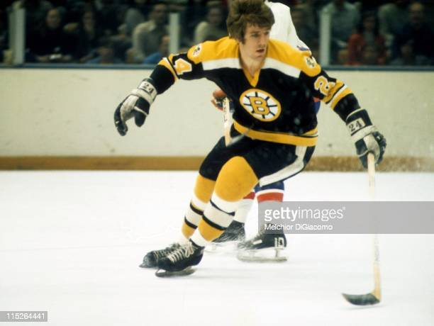 Terry O'Reilly of the Boston Bruins skates on the ice during an NHL game against the New York Islanders circa 1971 at the Nassau Coliseum in...
