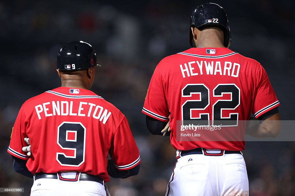 <a gi-track='captionPersonalityLinkClicked' href=/galleries/search?phrase=Terry+Pendleton&family=editorial&specificpeople=226766 ng-click='$event.stopPropagation()'>Terry Pendleton</a> #9 of the Atlanta Braves and <a gi-track='captionPersonalityLinkClicked' href=/galleries/search?phrase=Jason+Heyward&family=editorial&specificpeople=5043351 ng-click='$event.stopPropagation()'>Jason Heyward</a> #22 stand on first base during the eighth inning against the Miami Marlins at Turner Field on August 30, 2014 in Atlanta, Georgia.