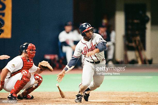 Terry Pendleton of the Atlanta Braves bats during a 1991 World Series game against the Minnesota Twins at the Hubert H Humphrey Metrodome in...