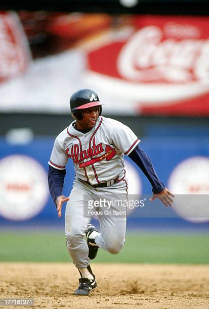 Terry Pendleton of the Atlanta Braves runs the bases against the New York Mets during an Major League Baseball game circa 1993 at Shea Stadium in the...