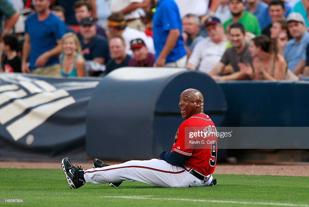Terry Pendleton #9 of the Atlanta Braves sits on the ground after avoiding a foul ball hit in his direction by Jack Wilson #2 in the second inning against the Washington Nationals at Turner Field on May 25, 2012 in Atlanta, Georgia.