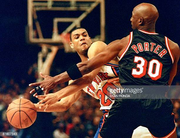 Terry Porter of the Miami Heat plays tight defense against Allan Houston of the New York Knicks in the third quarter of the fourth game of their...