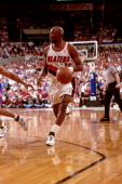 Terry Porter of the Portland Trail Blazers dribbles against the Phoenix Suns during a game played in 1992 at the Veterans Memorial Coliseum in...