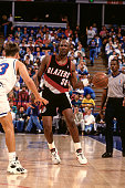 Terry Porter of the Portland Trail Blazers dribbles the ball against the Sacramento Kings during a game played circa 1994 at Arco Arena in Sacramento...
