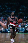 Terry Porter of the Portland Trail Blazers moves the ball up court against the Boston Celtics during a game played in 1989 at the Boston Garden in...