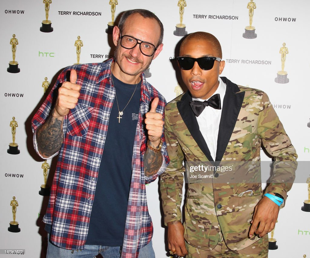 <a gi-track='captionPersonalityLinkClicked' href=/galleries/search?phrase=Terry+Richardson&family=editorial&specificpeople=758714 ng-click='$event.stopPropagation()'>Terry Richardson</a> and <a gi-track='captionPersonalityLinkClicked' href=/galleries/search?phrase=Pharrell+Williams&family=editorial&specificpeople=161396 ng-click='$event.stopPropagation()'>Pharrell Williams</a> attend the after party for the OHWOW & HTC celebration of the release of 'TERRYWOOD', sponsored by GQ and Disaronno at The Standard Hotel & Spa on December 7, 2012 in Miami Beach, Florida.